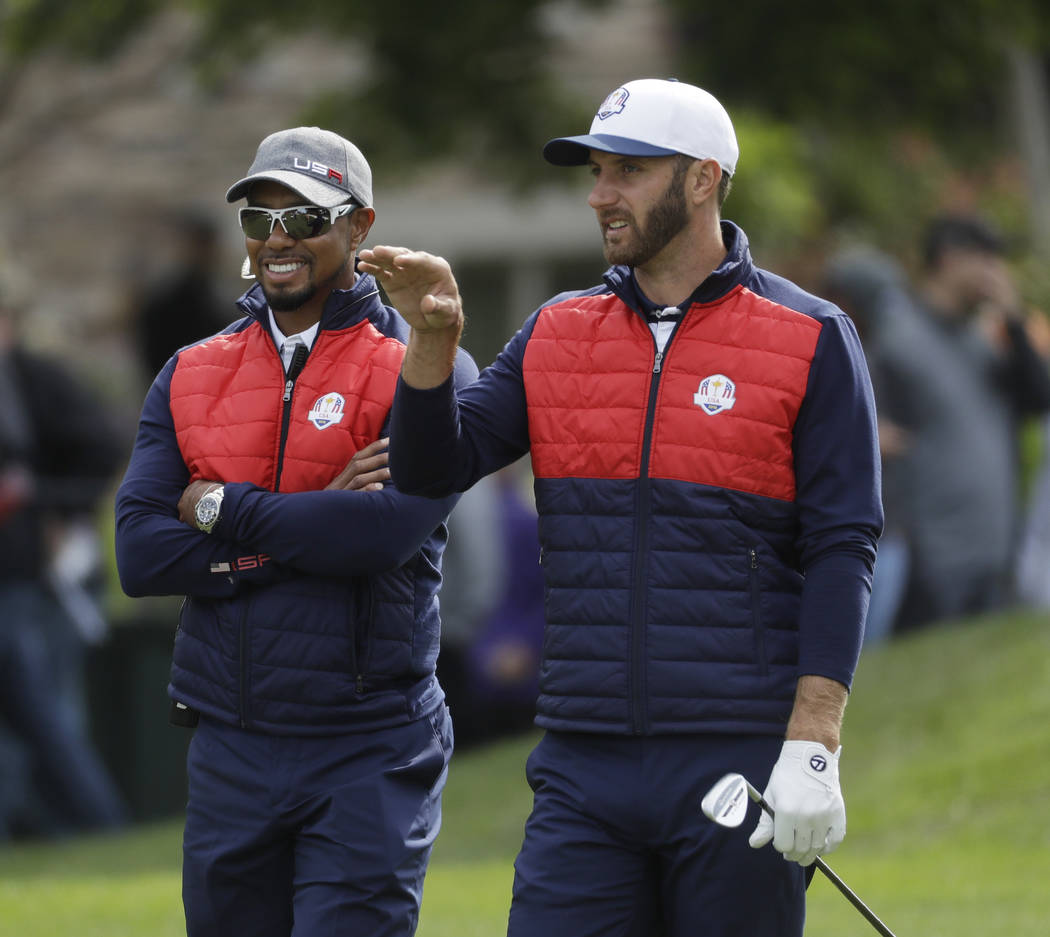 United States Dustin Johnson talks to United States vice-captain Tiger Woods on the fifth hole during a practice round for the Ryder Cup golf tournament Tuesday, Sept. 27, 2016, at Hazeltine Natio ...