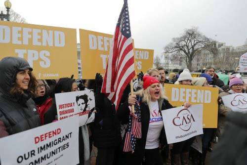CASA de Maryland, an immigration advocacy and assistance organization, holds a rally in Lafayette Park, across from the White House in Washington, Monday, Jan. 8, 2018, in reaction to the announce ...