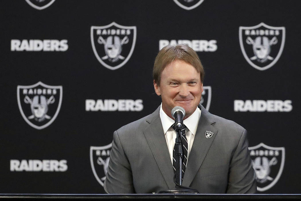 Oakland Raiders new head coach Jon Gruden smiles during an NFL football news conference in Alameda, Calif. Tuesday, Jan. 9, 2018.  (AP Photo/Marcio Jose Sanchez)