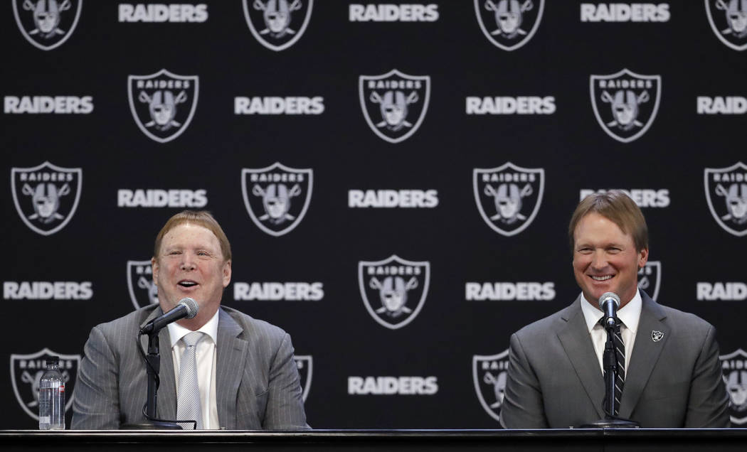 Oakland Raiders head coach Jon Gruden, right, and owner Mark Davis answer questions during an NFL football press conference Tuesday, Jan. 9, 2018, in Alameda, Calif. (AP Photo/Marcio Jose Sanchez)