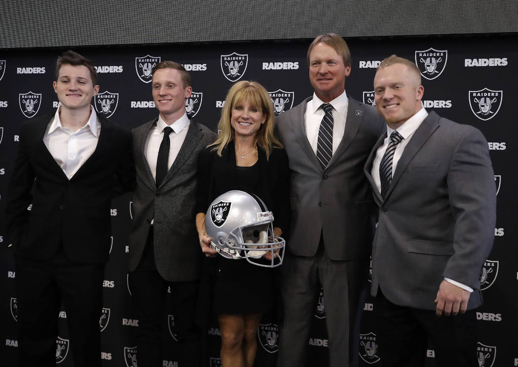 Oakland Raiders head coach Jon Gruden, second from right, poses for photographs with his family after an NFL football press conference Tuesday, Jan. 9, 2018, in Alameda, Calif. (AP Photo/Marcio Jo ...