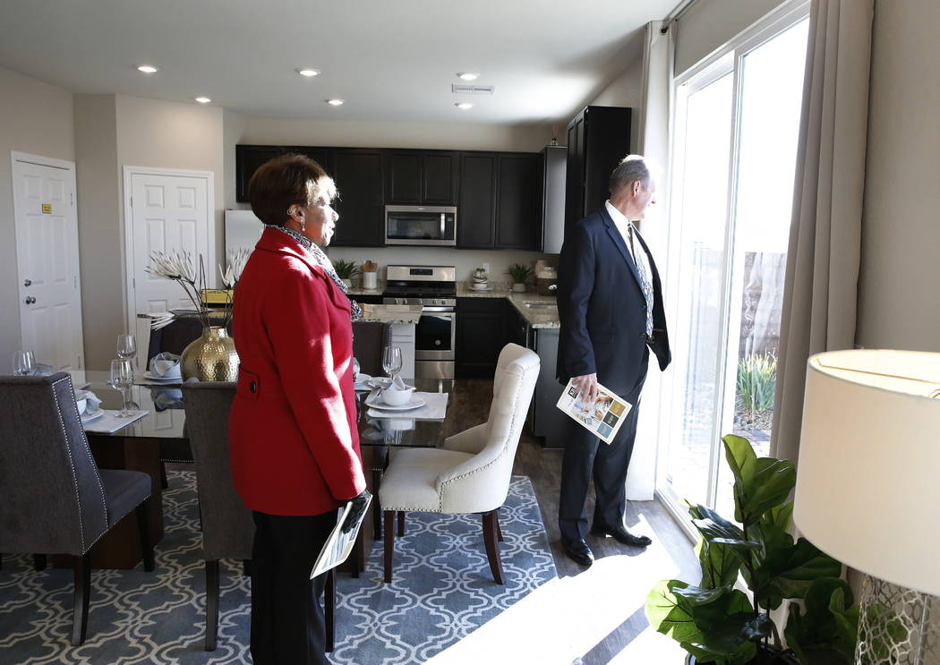 North Las Vegas City Councilwoman Pamela Goynes-Brown, left, and North Las Vegas Mayor John Lee, visit a two-story home on Desert Senna Street near West Carey Avenue and Revere Street in North Las ...