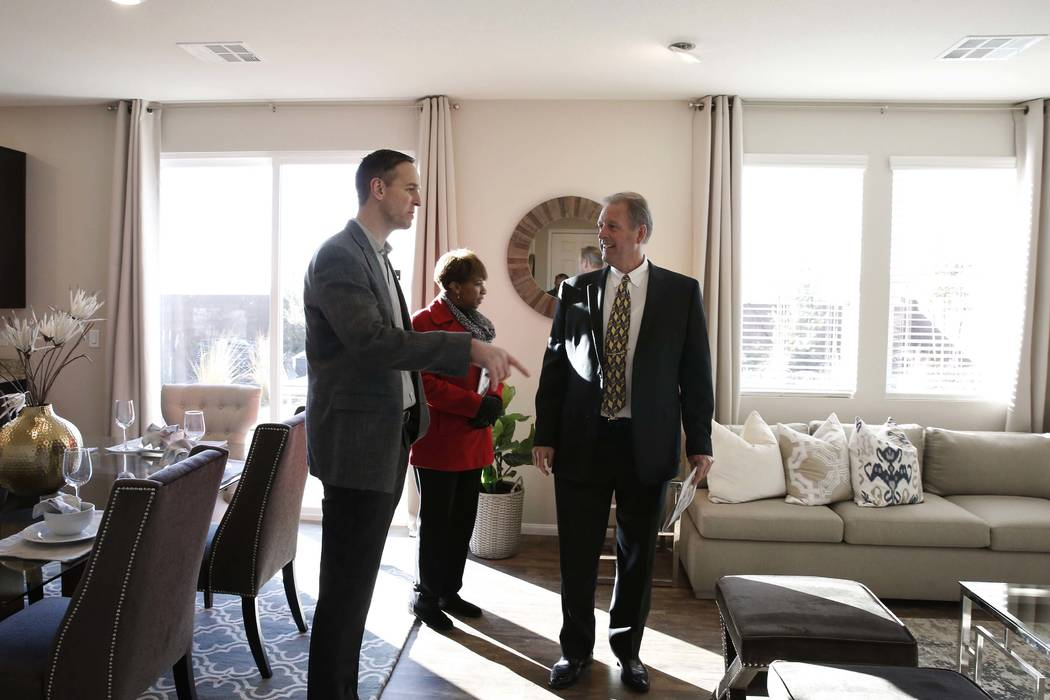 Brian Kunec, left, a division president for KB Home, leads a tour of Desert Mesa, spacious one- and two-story homes, to North Las Vegas Mayor John Lee, right, and Councilwoman Ward 2 Pamela Goynes ...