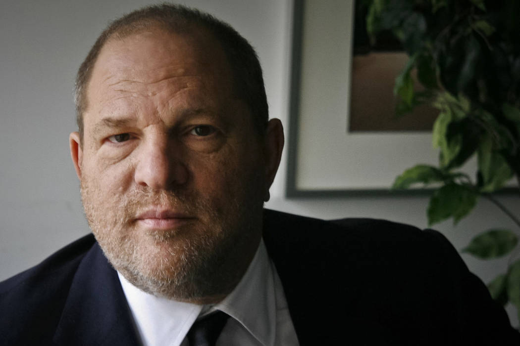 FILE - In this Nov. 23, 2011 file photo, film producer Harvey Weinstein poses for a photo in New York. Six women filed a federal lawsuit against Weinstein on Wednesday, Dec. 6, 2017, claiming that ...