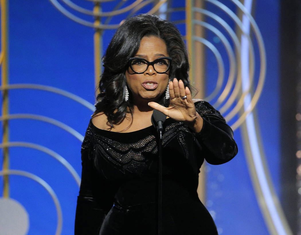 This image released by NBC shows Oprah Winfrey accepting the Cecil B. DeMille Award at the 75th Annual Golden Globe Awards in Beverly Hills, Calif., on Sunday, Jan. 7, 2018. (Paul Drinkwater/NBC v ...