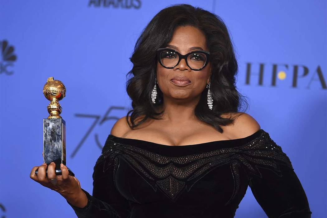 Oprah Winfrey poses in the press room with the Cecil B. DeMille Award at the 75th annual Golden Globe Awards at the Beverly Hilton Hotel on Sunday, Jan. 7, 2018, in Beverly Hills, Calif. (Jordan S ...