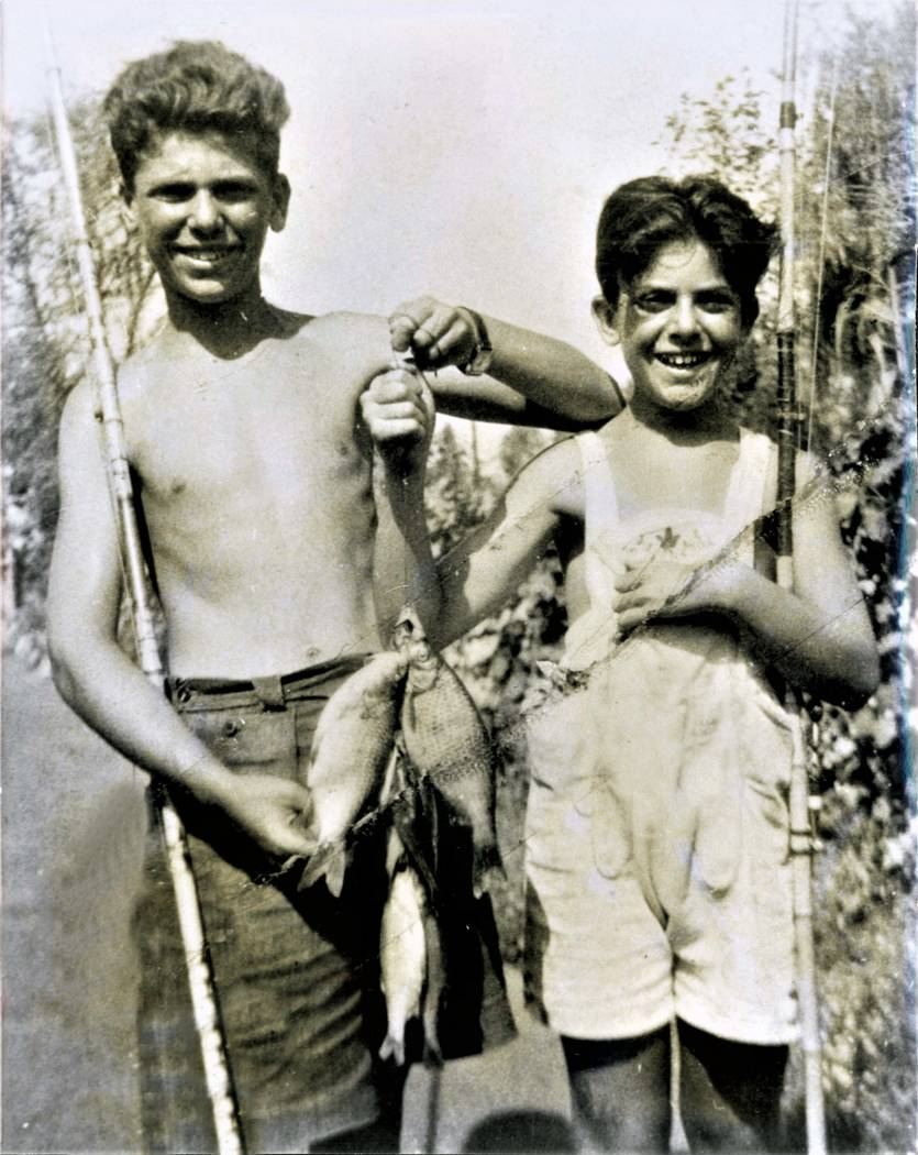 """Andris Nasser, left, and his younger brother Stephen """"Pista"""" Nasser are shown fishing near their home in Budapest. Andris died in Pista's arms a month before their concentration camp was liberated ..."""