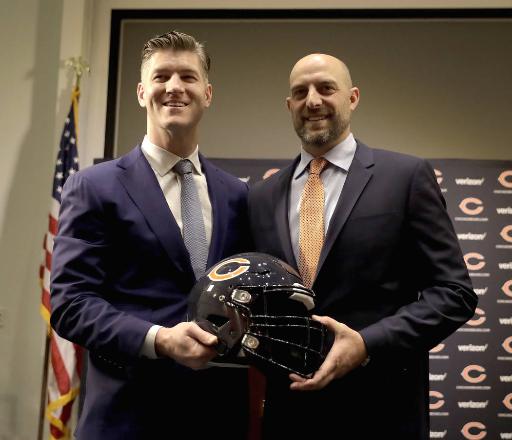 Chicago Bears general manager Ryan Pace, left, poses with Matt Nagy after Pace introduced Nagy as the club's 16th head coach in franchise history during an NFL football news conference Tuesday, Ja ...