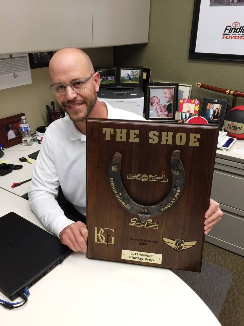 Findlay Automotive Findlay Automotive Group Director of Operations Robby Findlay is seen with last year's plaque for the Big City Showdown between Findlay Prep and Bishop Gorman. The two schools ...