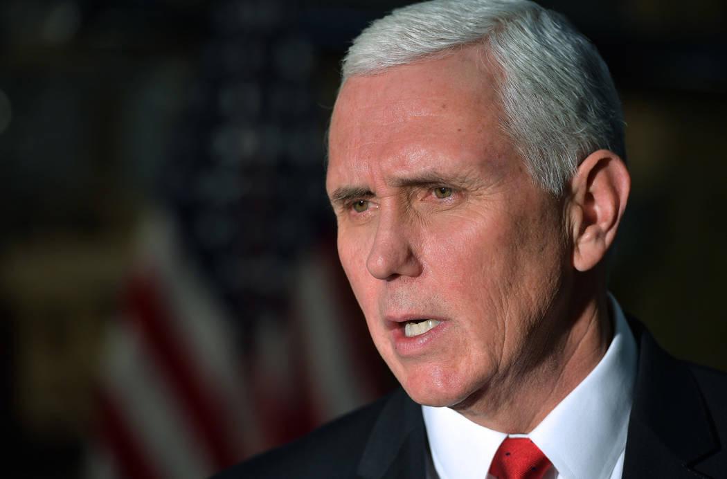 U.S. Vice President Mike Pence speaks to reporters in a hangar at Bagram Air Base in Afghanistan, Dec. 21, 2017. (Mandel Ngan/Pool via AP, File)
