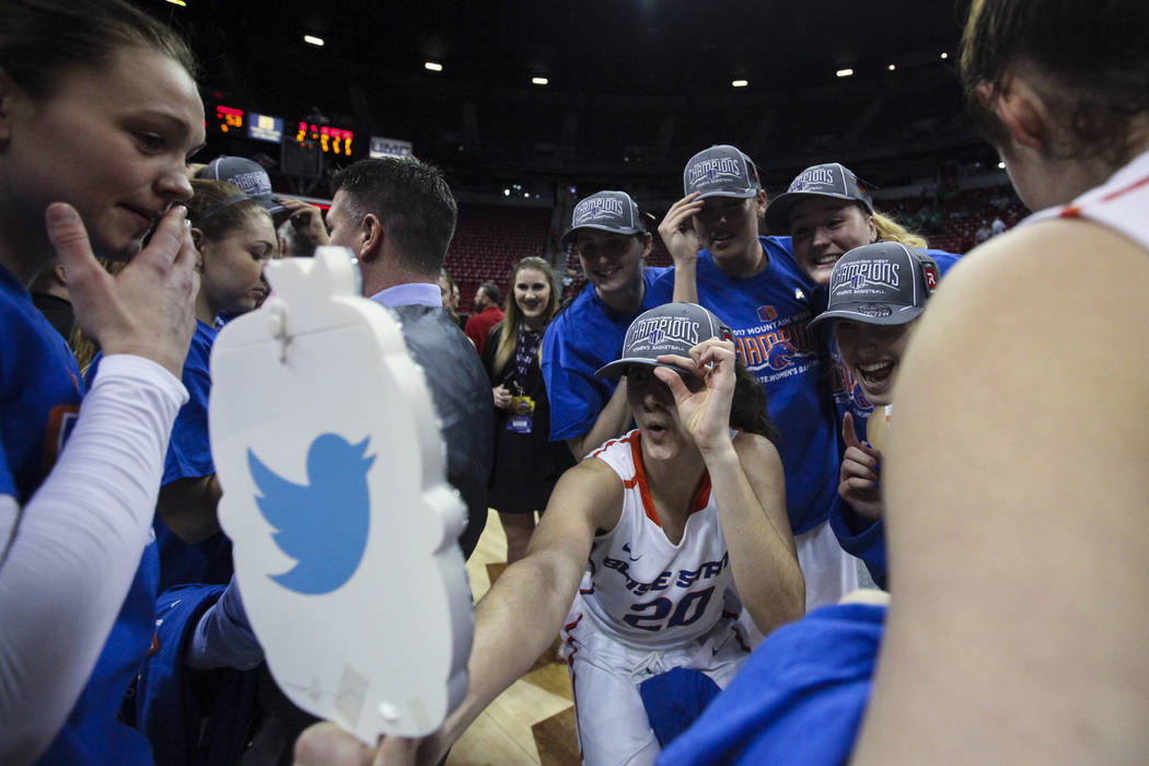Boise State celebrates its win after the Mountain West Conference women's basketball championship game at the Thomas & Mack Center in Las Vegas on Friday, March 10, 2017. Boise State defeated  ...