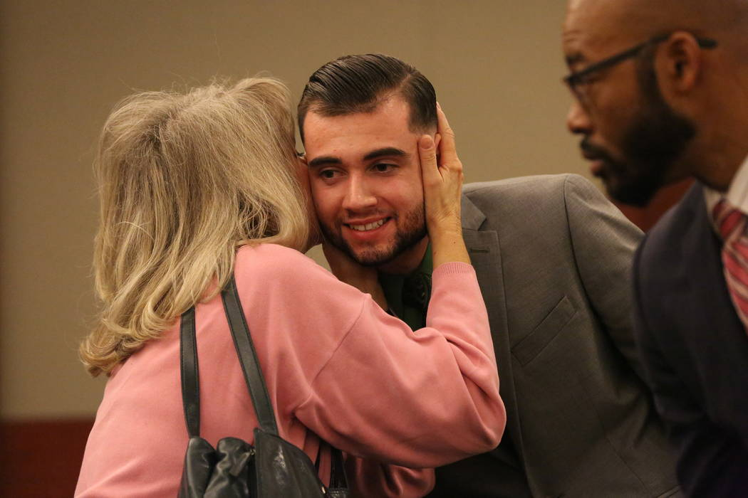 Joshua Honea, the former police Explorer convicted in December of sexual assault of a minor, receives an embrace from a family friend after his hearing to request a new trial at the Regional Justi ...