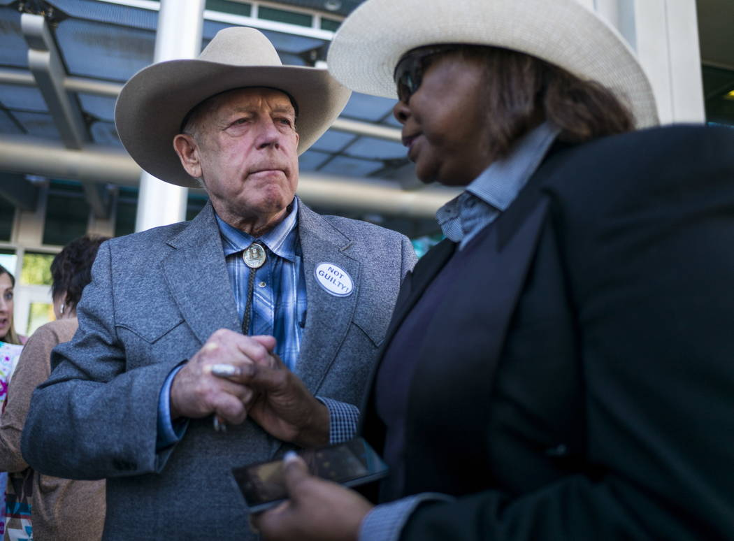 Rancher Cliven Bundy speaks with supporter Annette Walker-Goggins after addressing supporters and journalists at Metropolitan Police Department headquarters on Wednesday, Jan. 10, 2018, in Las Veg ...