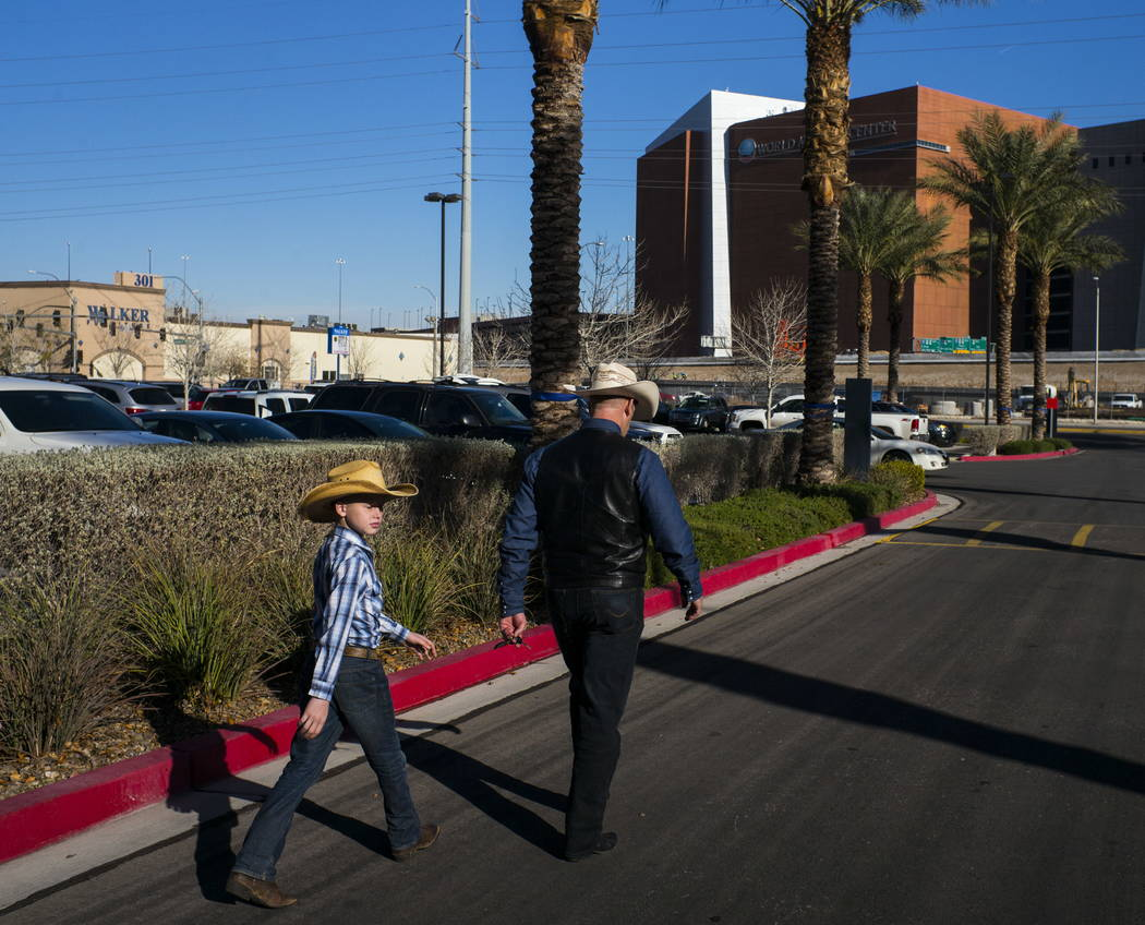 Ryan Bundy and his son Oak, 10, at Metropolitan Police Department headquarters on Wednesday, Jan. 10, 2018. Chase Stevens Las Vegas Review-Journal @csstevensphoto