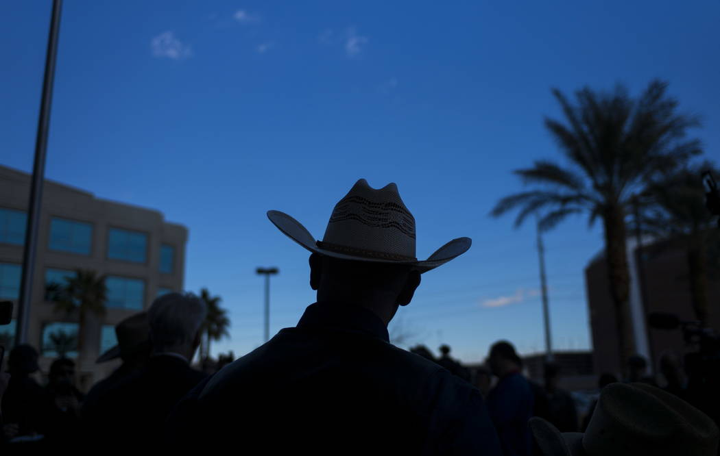 Ryan Bundy, son of rancher Cliven Bundy, listens to his father speak at Metropolitan Police Department headquarters on Wednesday, Jan. 10, 2018. Chase Stevens Las Vegas Review-Journal @csstevensphoto
