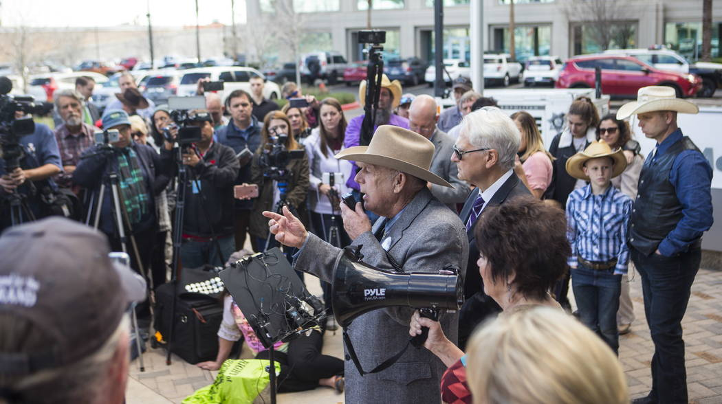 Rancher Cliven Bundy, center, address supporters and journalists at Metropolitan Police Department headquarters on Wednesday, Jan. 10, 2018. Chase Stevens Las Vegas Review-Journal @csstevensphoto