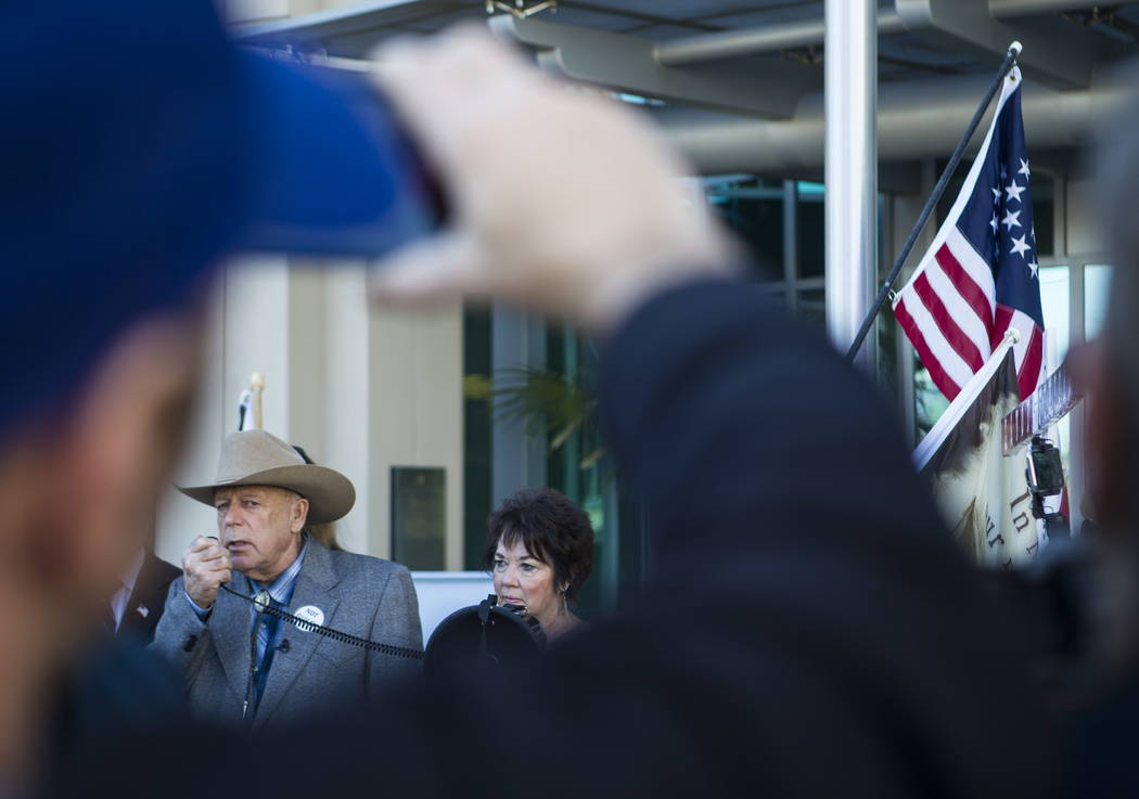 Rancher Cliven Bundy, standing next to his wife Carol, address supporters and journalists at Metropolitan Police Department headquarters on Wednesday, Jan. 10, 2018. Chase Stevens Las Vegas Review ...