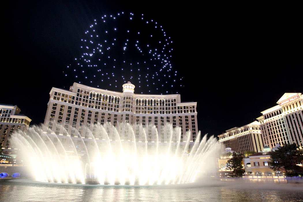 Lighted drones fly over the Bellagio as part of the Intel Shooting Star show as part of the Consumer Electronics Show at the Las Vegas Convention Center Wednesday, Jan. 10, 2018. K.M. Cannon Las V ...