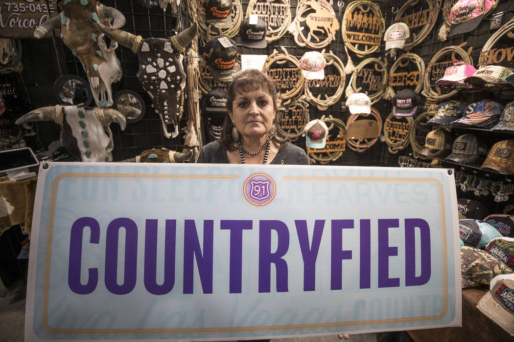 Julie Craig, the owner of Countryfied Apparel, at her Stetson Country Christmas Expo booth at the Sands Expo, on Thursday, Dec. 7, 2017, with her vendor booth sign from the Route 91 Harvest festiv ...