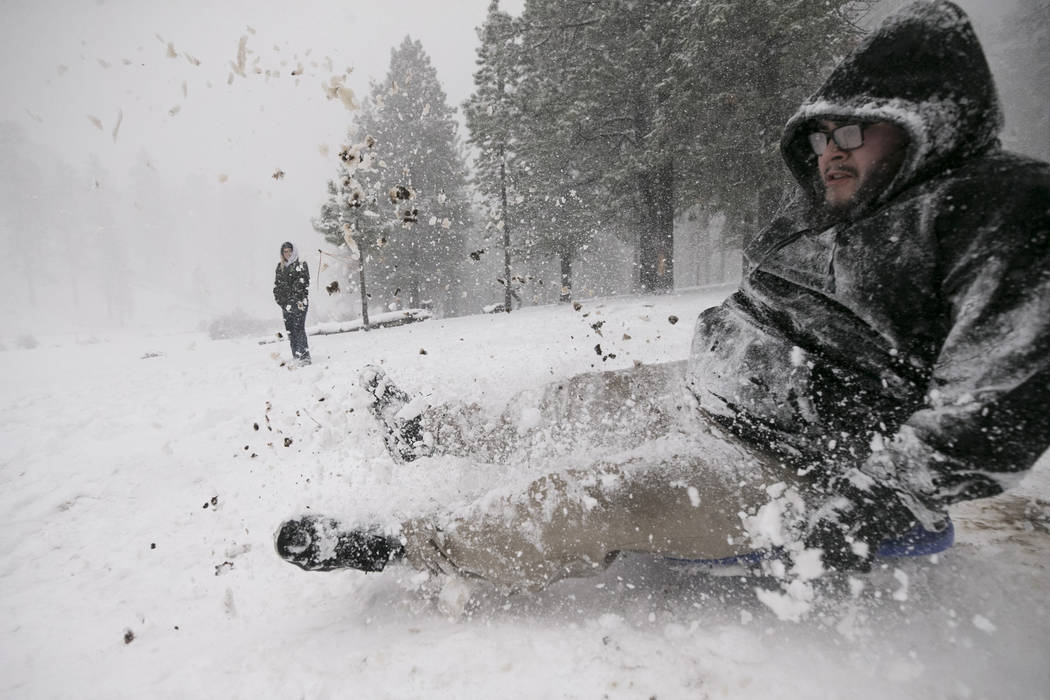 Charles Smith of Las Vegas sleds in the snow at Upper Lee Meadows in Lee Canyon outside of Las Vegas, Tuesday, Jan. 9, 2018. Richard Brian Las Vegas Review-Journal @vegasphotograph