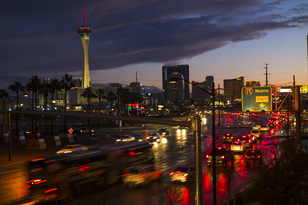 Traffic along Grand Central Parkway near Charleston Boulevard as the sun sets after a long day of rain in Las Vegas on Tuesday, Jan. 9, 2018. Chase Stevens Las Vegas Review-Journal @csstevensphoto