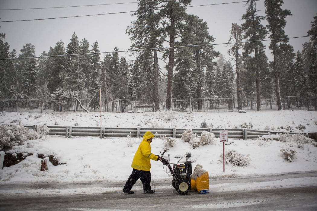 A maintenance worker attends to snow in the parking lot of the Mount Charleston Lodge on Tuesday, Jan. 9, 2018. Patrick Connolly Las Vegas Review-Journal @PConnPie