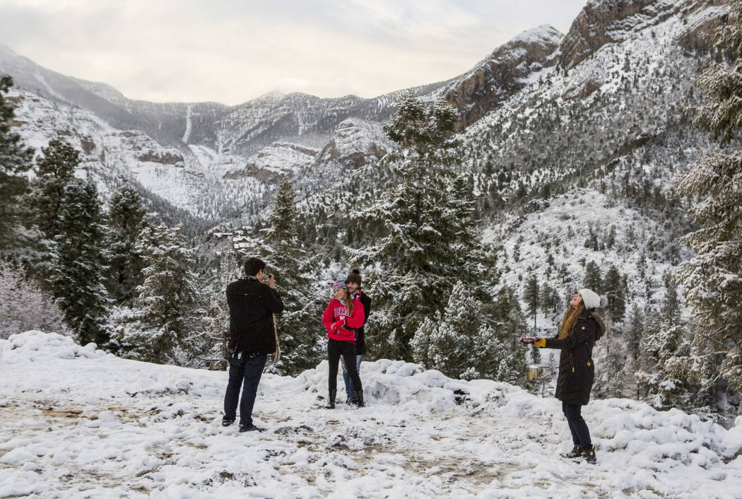 Las Vegas residents, from left, Ronnie Joseph, Ashley Frederick, Michael Joseph and Joanna Joseph enjoy the snow at Mount Charleston on Tuesday, Jan. 9, 2018. Patrick Connolly Las Vegas Review-Jou ...