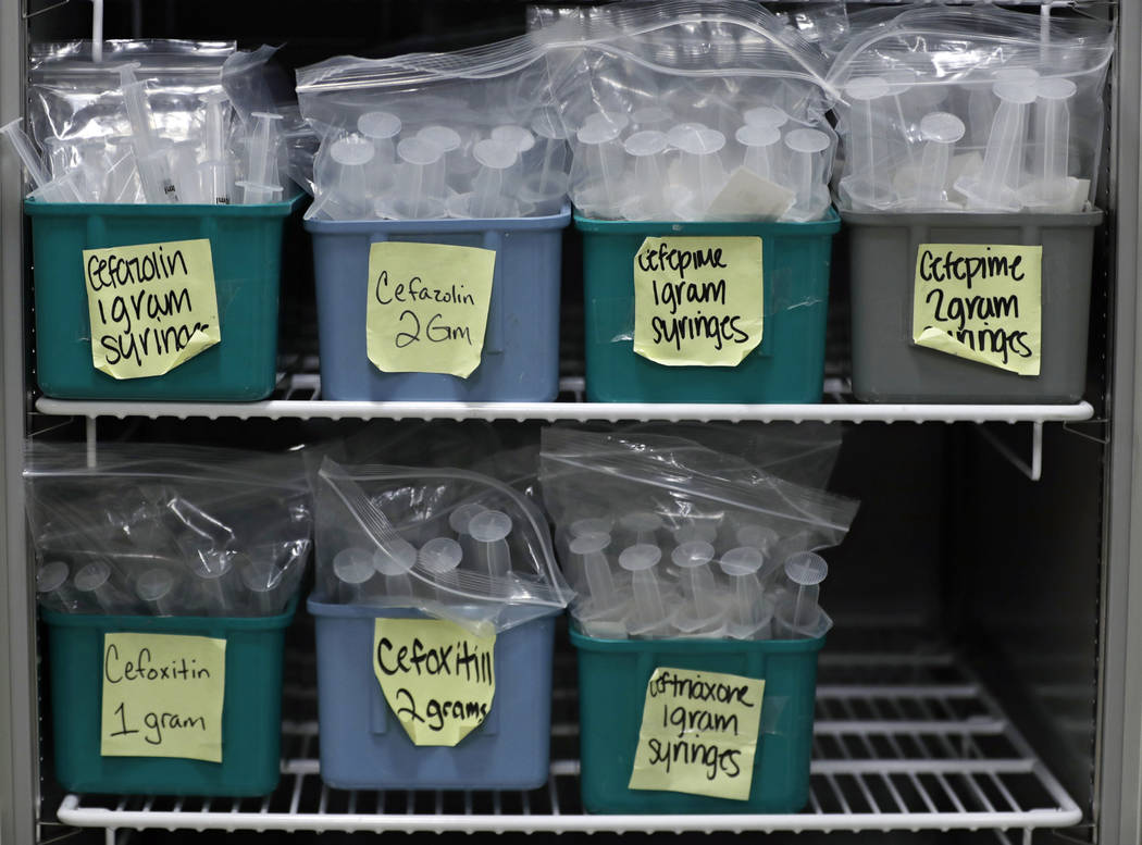 In this Monday, Jan. 8, 2018, photo, a refrigerator is filled with finished batches of stored syringes for I.V. pushes at ProMedica Toledo Hospital, in Toledo, Ohio. A nasty flu season is hitting  ...