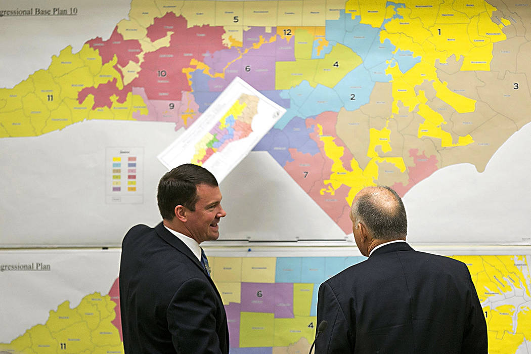 In this Feb. 16, 2016, file photo, Republican state Sens. Dan Soucek, left, and Brent Jackson, right, review historical maps during The Senate Redistricting Committee for the 2016 Extra Session in ...