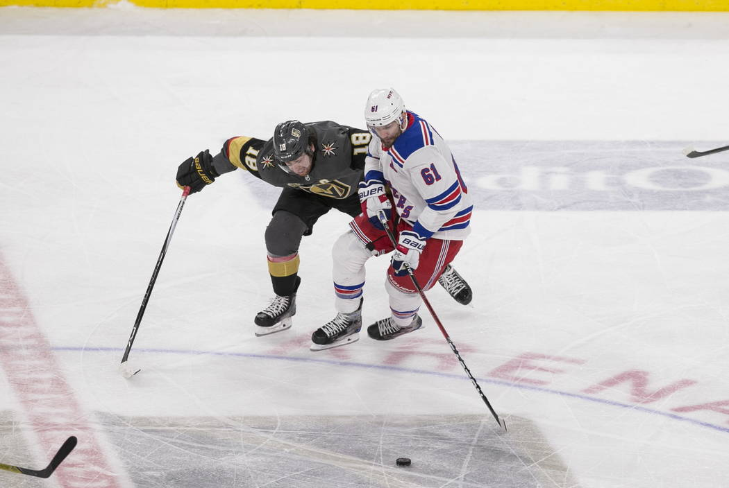 Vegas Golden Knights left wing James Neal (18) pressures New York Rangers right wing Rick Nash (61) during the second period of an NHL hockey game between the Vegas Golden Knights and the New York ...