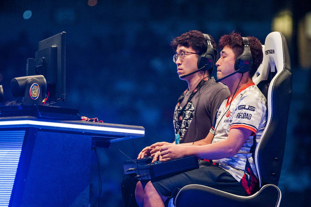 "Jae Min Bae aka ""Knee"", right, and Choi Jin Woo aka ""Saint""  face off in Tekken 7 during the Evo 2017 Championship Series, a fighting game tournament, at the Ma ..."