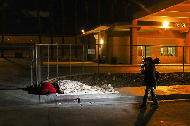 A homeless person sleeps along A Street during the Southern Nevada Homeless Census in downtown Las Vegas on Tuesday, Jan. 24, 2017. (Chase Stevens/Las Vegas Review-Journal) @csstevensphoto