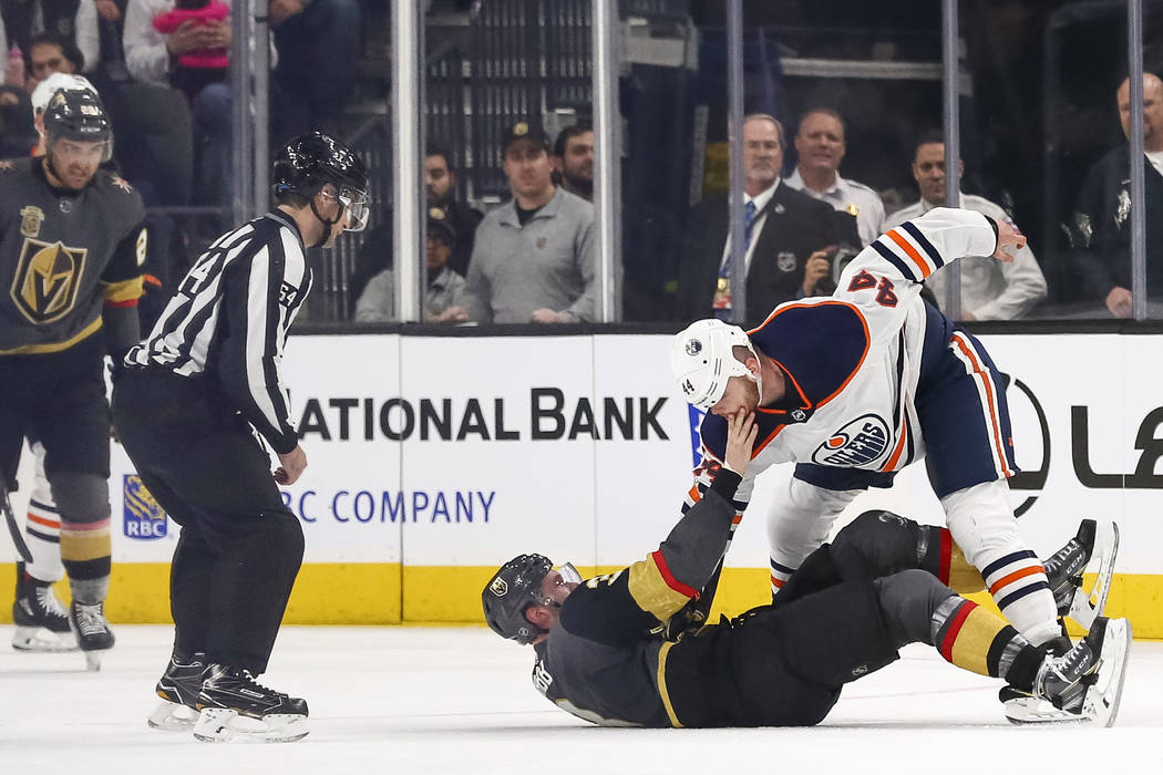 Vegas Golden Knights defenseman Brayden McNabb (3) and Edmonton Oilers right wing Zack Kassian (44) fight during the second period of an NHL hockey game between the Vegas Golden Knights and the Ed ...