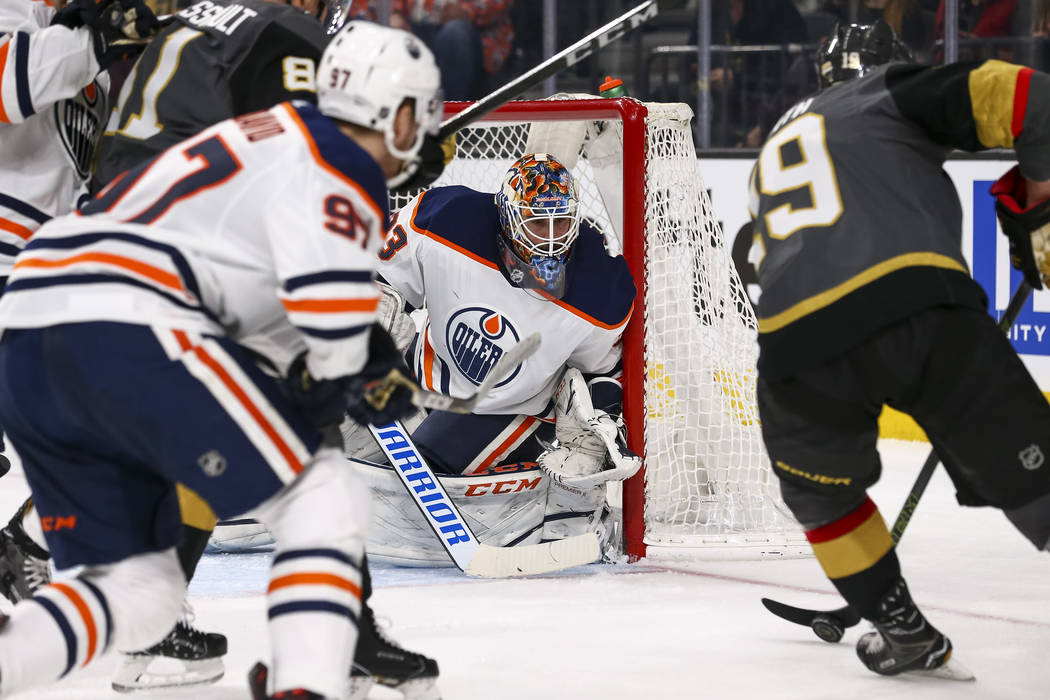 Edmonton Oilers goaltender Cam Talbot (33) keeps his eye on the puck as Vegas Golden Knights right wing Reilly Smith (19) attacks before scoring a goal during the second period of an NHL hockey ga ...