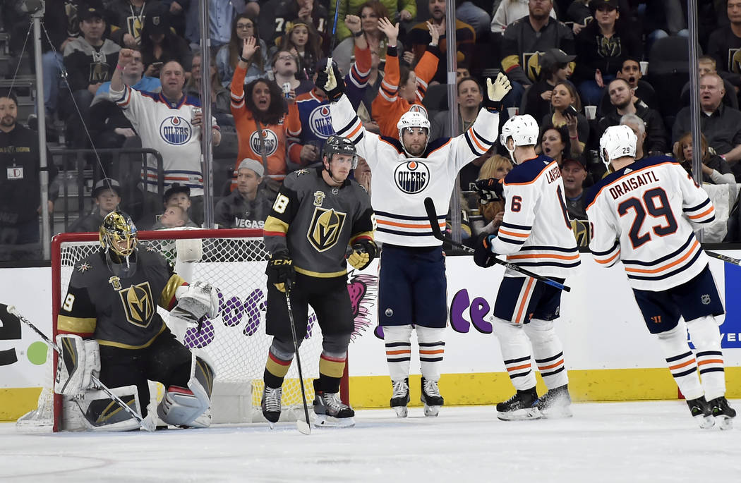Edmonton Oilers left wing Patrick Maroon (19) celebrates after scoring a goal against Vegas Golden Knights goalie Marc-Andre Fleury, left, during the second period of an NHL hockey game Saturday,  ...