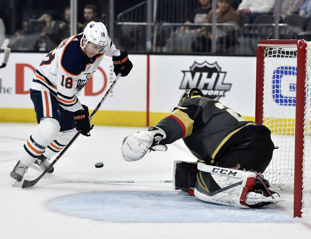 Edmonton Oilers center Ryan Strome (18) shoots against Vegas Golden Knights goalie Marc-Andre Fleury during the first period of an NHL hockey game Saturday, Jan. 13, 2018, in Las Vegas. (AP Photo/ ...