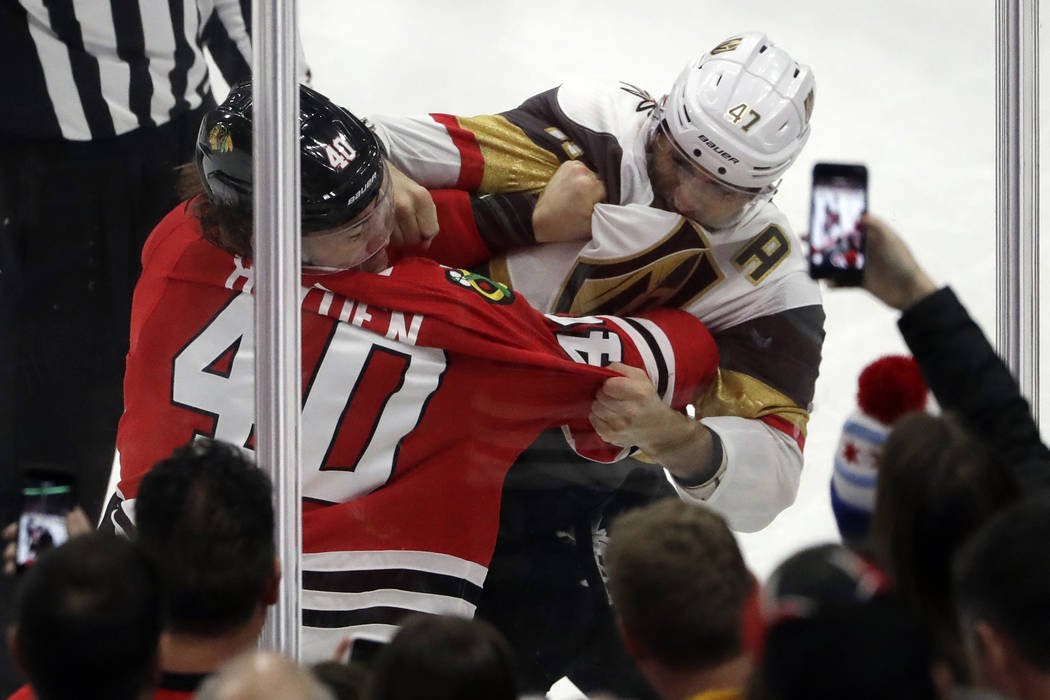 Chicago Blackhawks right wing John Hayden, left, and Vegas Golden Knights defenseman Luca Sbisa fight during the second period of an NHL hockey game Friday, Jan. 5, 2018, in Chicago. (AP Photo/Nam ...