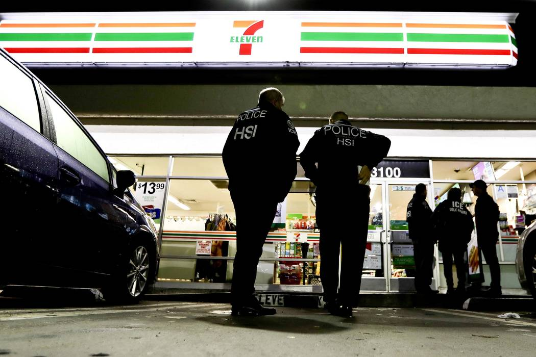 U.S. Immigration and Customs Enforcement agents serve an employment audit notice at a 7-Eleven convenience store Wednesday, Jan. 10, 2018, in Los Angeles. Agents said they targeted about 100 7-Ele ...