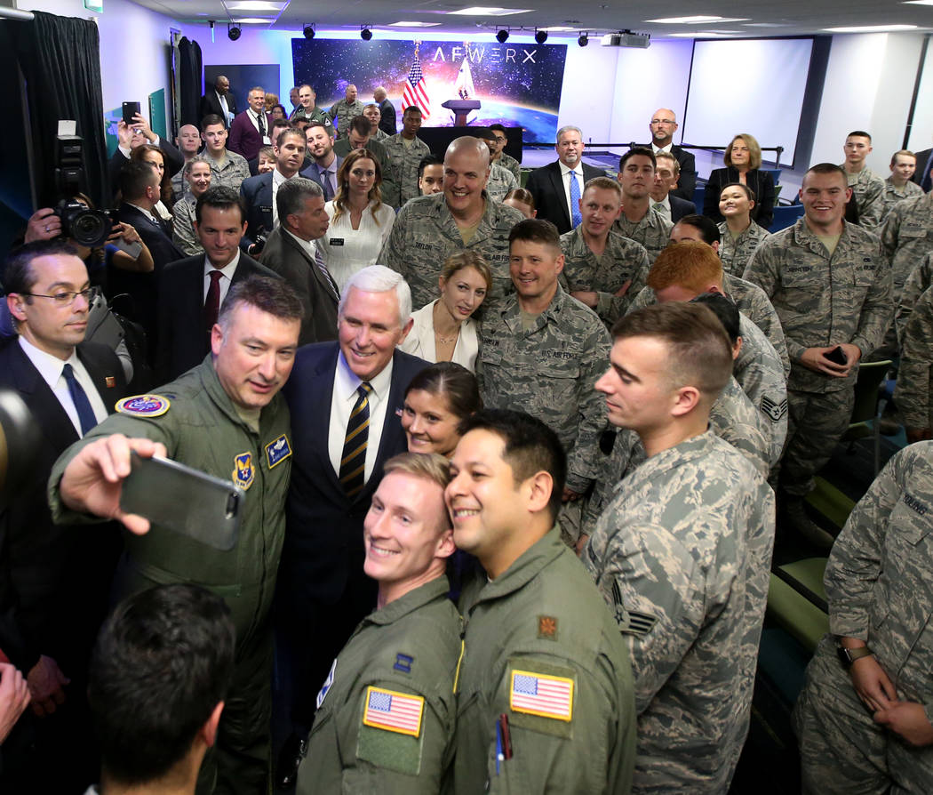 Lt. Col. Dave Hardin, left, takes a selfie with Vice President Mike Pence at the grand opening of AFWERX Vegas, a work space for the Air Force program that fosters entrepreneurial innovation engag ...