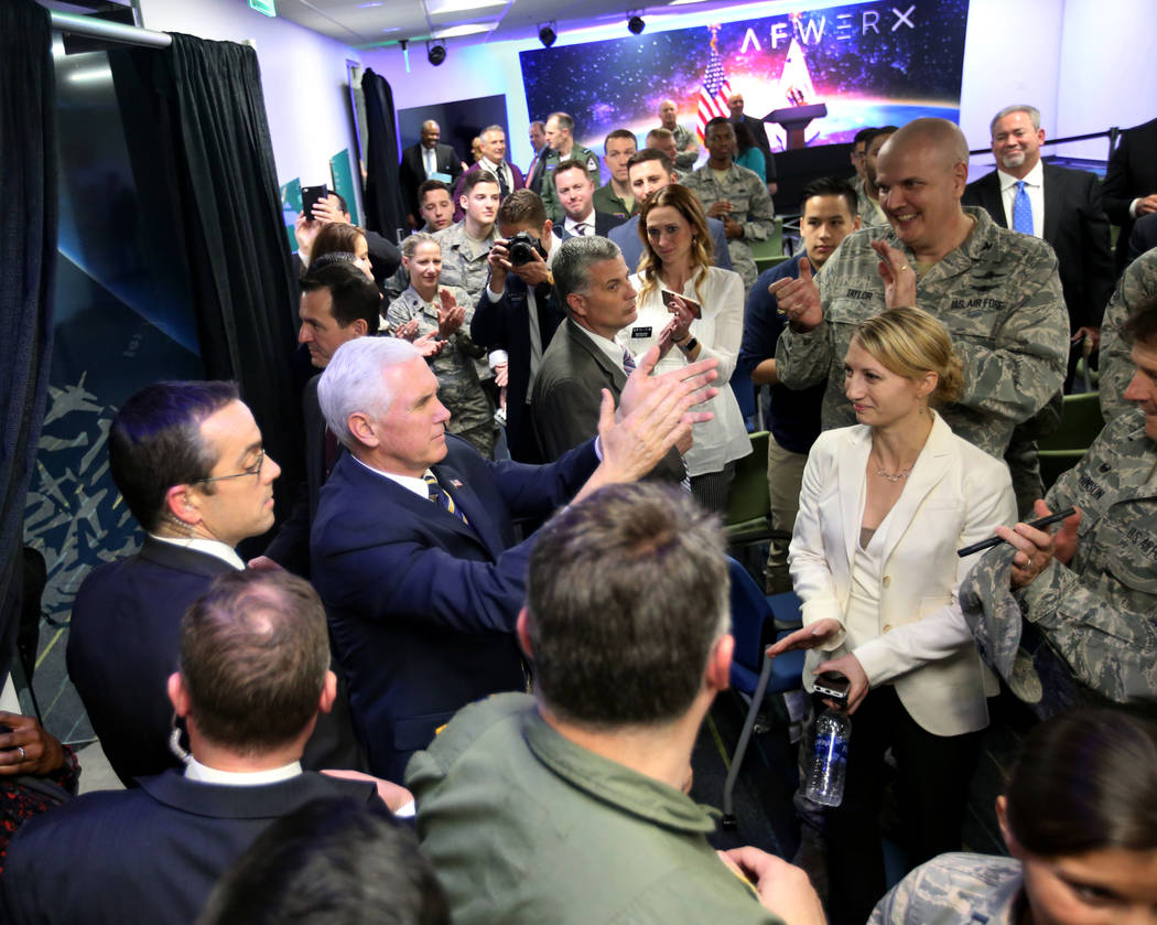 Vice President Mike Pence applauds airmen and their families at the grand opening of AFWERX Vegas, a work space for the Air Force program that fosters entrepreneurial innovation engagements. The i ...