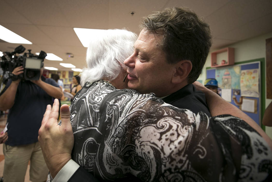 Clark County School District Superintendent Pat Skorkowsky, left, hugs CCSD Board of Trustees member Carolyn Edwards after announcing his retirement on Thursday, Sept. 7, 2017. Richard Brian Las V ...