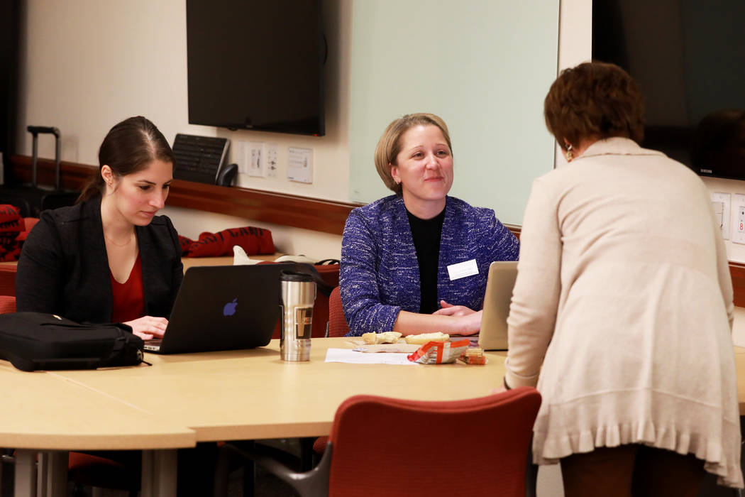 From left, Vaneh Darakjian, director of Communications and Marketing, and Valarie Burke, director of Graduate Student Services, talk with Gayle Moore during a writing boot camp at Lied Library in  ...