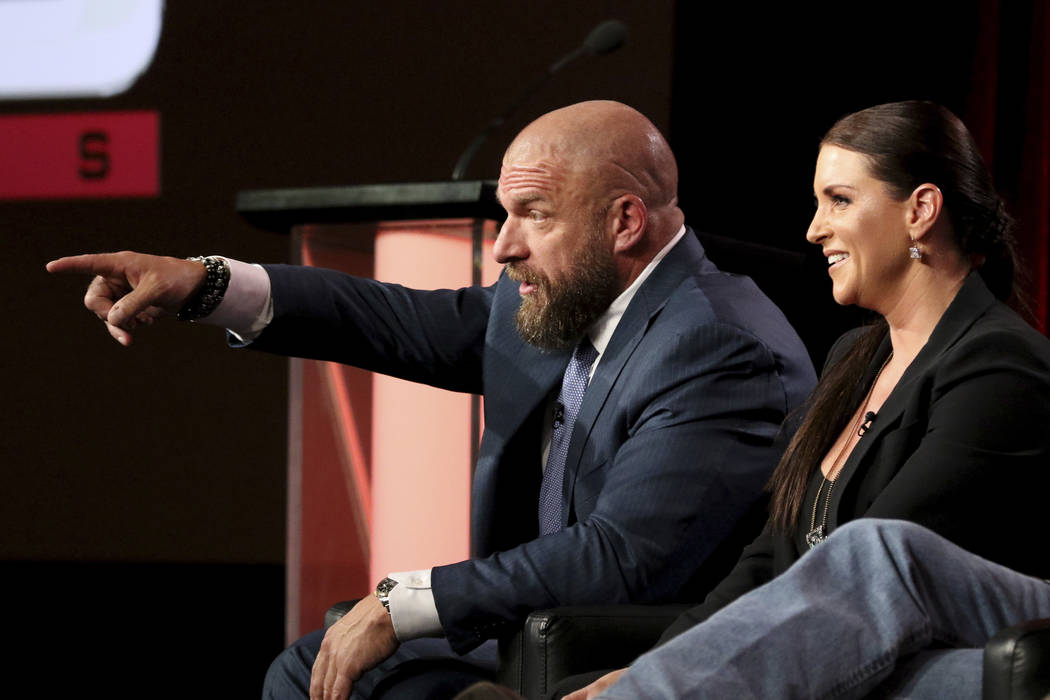 """Paul """"Triple H"""" Levesque, left, and Stephanie McMahon participate in the """"WWE Monday Night Raw: 25th Anniversary"""" panel during the NBCUniversal Television Criti ..."""