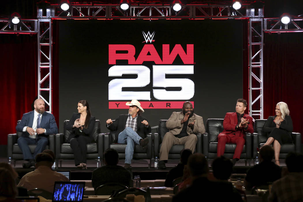 """Paul """"Triple H"""" Levesque, from left, Stephanie McMahon, Shawn Michaels, Mark Henry, The Miz and Maryse participate in the """"WWE Monday Night Raw: 25th Anniversary&quo ..."""