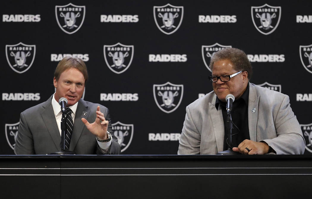 Oakland Raiders new head coach Jon Gruden, left, answers a question next to general manager Reggie McKenzie during an NFL football press conference Tuesday, Jan. 9, 2018, in Alameda, Calif. (AP Ph ...