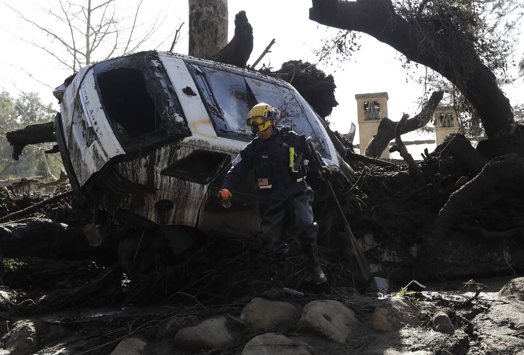 Eight dead in California mudslides, rivers of mud wipe out homes