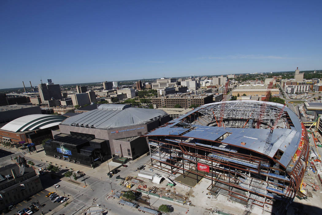 In this photo taken June 6, 2017, construction continues on the Milwaukee Bucks new NBA basketball arena in downtown Milwaukee. Minnesota-based Mortenson Construction employees have been stretchin ...