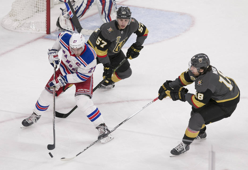 New York Rangers defenseman Ryan McDonagh (27) and Vegas Golden Knights left wing James Neal (18) vie for the puck as Knights left wing David Perron (57) follows behind during the first period of  ...