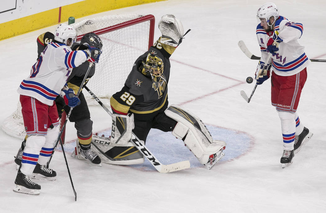 Vegas Golden Knights goaltender Marc-Andre Fleury (29) deflects a shot on goal during the second period of an NHL hockey game between the Vegas Golden Knights and the New York Rangers at the T-Mob ...