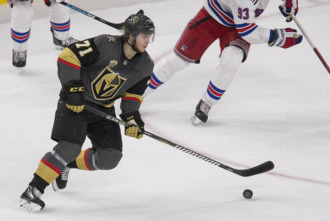 Vegas Golden Knights center William Karlsson (71) controls the puck as New York Rangers center Mika Zibanejad (93) closes in during the second period of an NHL hockey game between the Vegas Golden ...